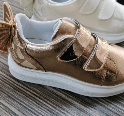 CARAMELO BOW TRAINER IN ROSE GOLD